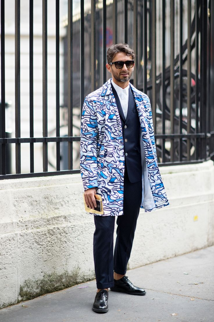 Simone Marchetti - The Cut. Gotta luv the way he wraps up the common power suit with an abstract coat that pops and creates an element of fun to the look.