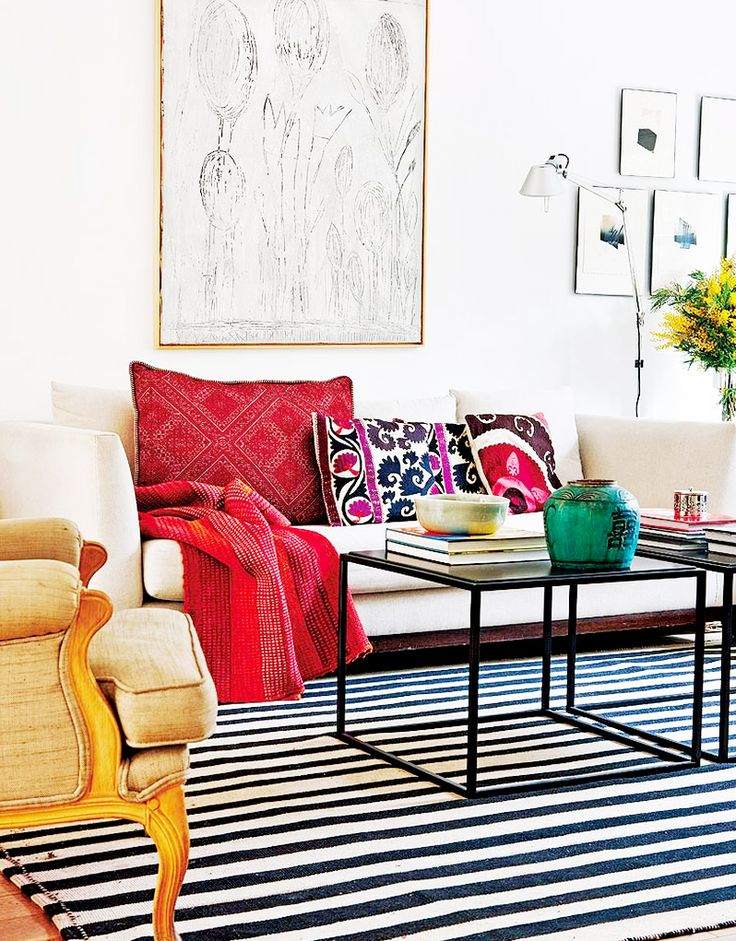 Striped rug + metal table + embroidered pillows