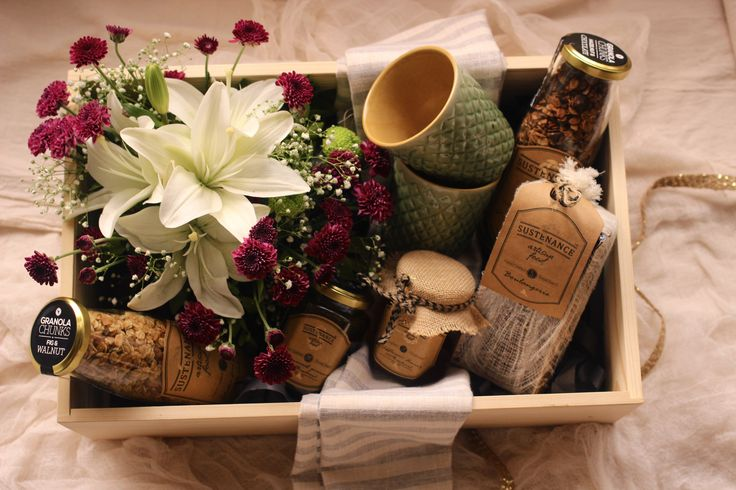 Our indulgence hamper has a delicious selection of artisanal preserves, wildflower honey, spiced pumpkin bread, cranberry pistachio granola, handcrafted cups and an elegant floral arrangement.