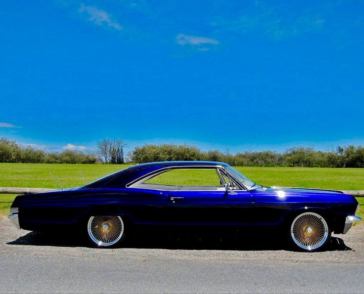 65 Chevy Impala........ not much of a fan of Low Riders but this BAD BOY can't be denied.
