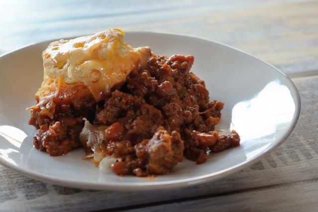 Serve this hungry jack casserole to your hungry family. These tasty beef and beans are topped with easy biscuits and shredded cheddar cheese.