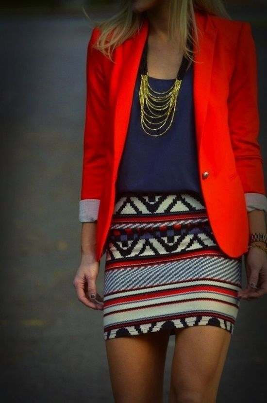 Aztec skirt with purple blouse and red blazer, accessories with a gold necklace