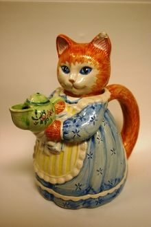 I have this one - CAT TEAPOT Avon Collectible