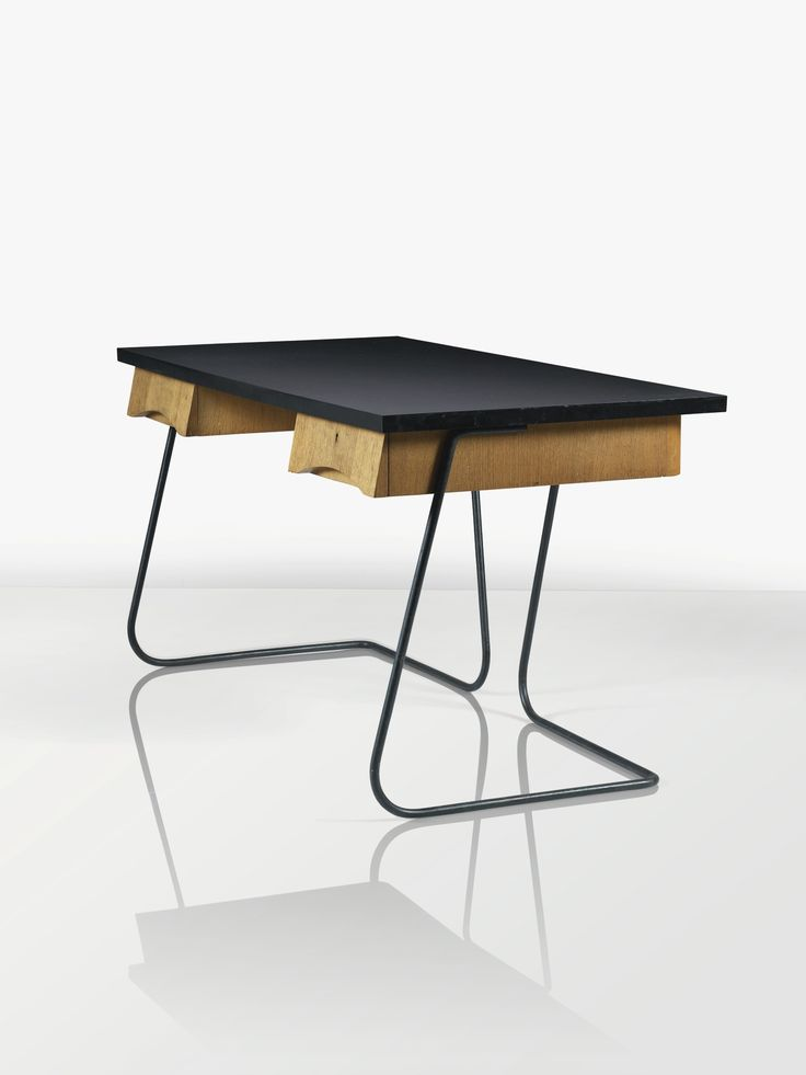JEAN ROYÈRE 1902 - 1981 BUREAU, 1954 AN OAK, BLACK STRATIFIED WOOD AND METAL DESK BY JEAN ROYÈRE, 1954 | Lot | Sotheby's