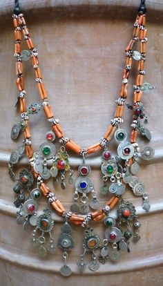 by Faouzi Creations | A fabulous two strand necklace made up of a collection of mixed Berber earrings, Moroccan zebra shells and branch coral | 800£