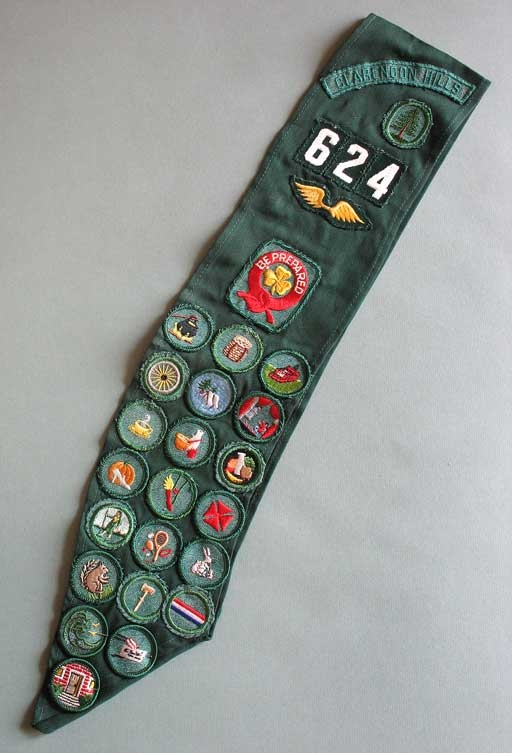 Girl Scout badges. my sash was also very full. when they changed to a vest, I had to resew every single badge. I was so proud of how many I had!