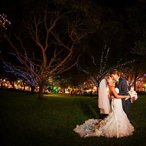 Real Weddings - In Bliss Weddings: The newlyweds took a picture outside of the reception by lighted trees. It was a beautiful background for their picture. Photo Credit: Limelight Photography- See more at: http://inblissweddings.com/real-weddings/story/shana_and_benjamin/295#sthash.wpDYABc4.dpuf