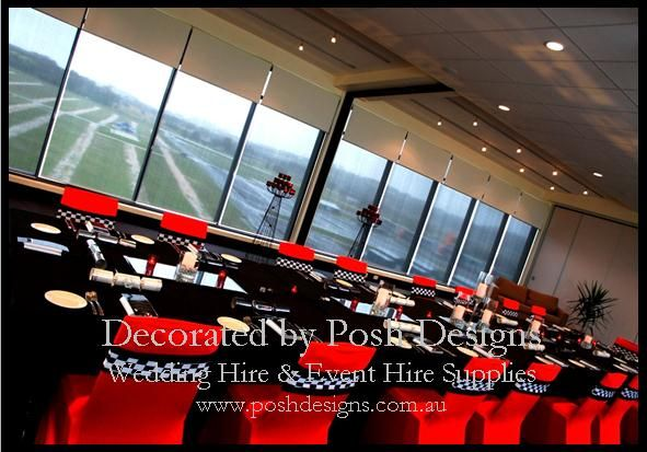 Red lycra chair covers, black tablecloths, black and white checked lycra bands, candles and mirrored tiles all for hire. Australia wide. Visit www.poshdesigns.com.au for more photos and info, or email lisa@poshdesigns.com.au for pricing packages