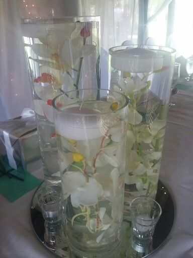 3 vases with submerged silk flowers