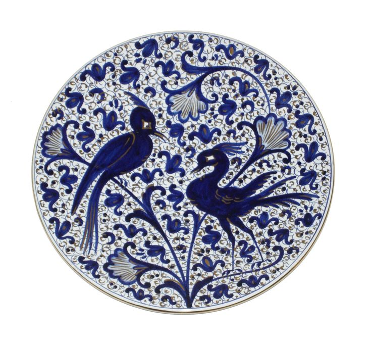 A maiolica plate from the Italian city of Faenza decorated in Pomegranate style of blue and gold