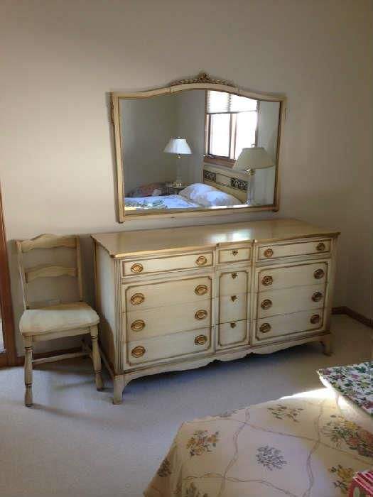 "Found on EstateSales.NET: Thomasville bedroom furniture set -  lovely dresser and mirror, plus a desk chair shown here.   The dresser is 60""w x 20""d x 34""h. Mirror measures 48""w x 37""h.  All three are in perfect condition."