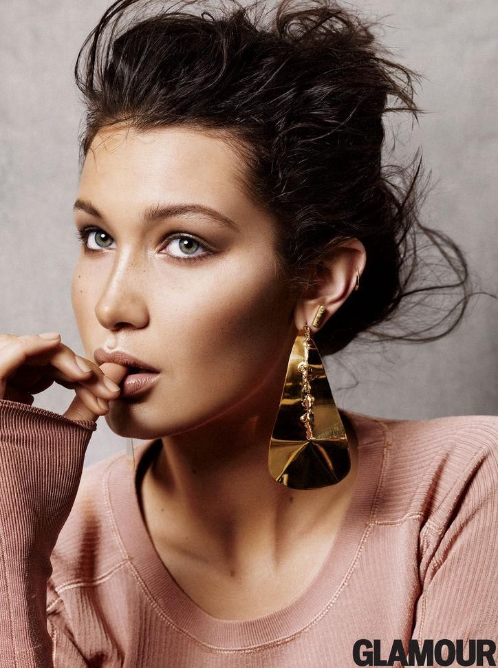Model Bella Hadid in Glamour, wearing Celine earrings and a Sonia by Sonia Rykiel sweater