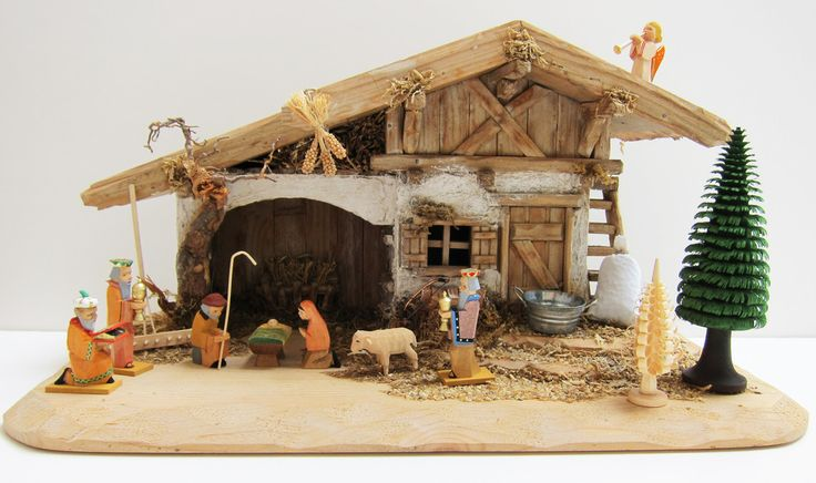 German Crib - Nativity - Krippen - Creche Set Stable, Helbig Figures, German Accessories. An exquisite hand-carved Bavarian Stable.  Architectural detail is charming - hay crib on the back wall, ladder on the right, woodpile, two windows, etc. Nativity figures from the Helbig Workshop in the Erzgebirge, Germany.  Accessories from Bavaria. Two hand-shaved trees from the Erzgebirge. A one-of-a-kind nativity set. Available at www.mygrowingtraditions.com