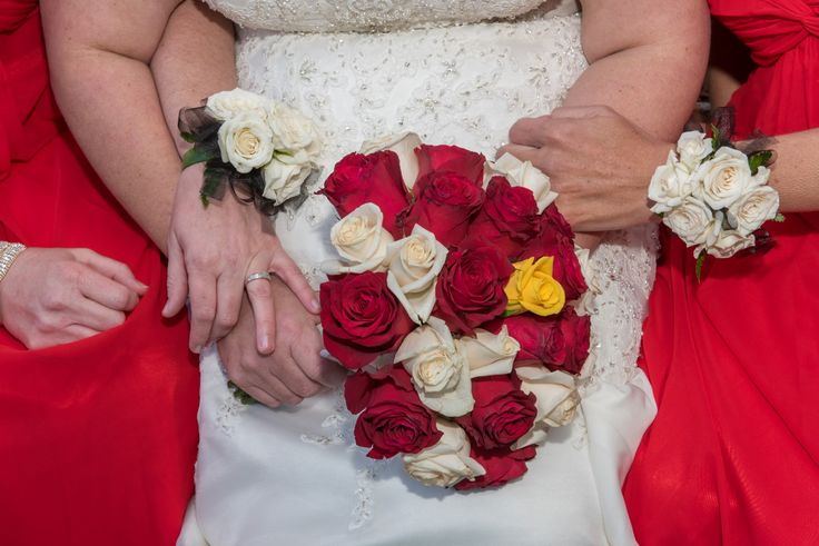 Wedding photographer - Candid Photos of a Lifetime  Bride carried bouquet, bridesmaid wore corsages.