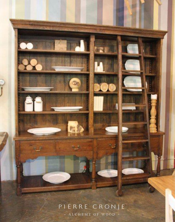 A Pierre Cronje Artois Bookcase in French Oak dark brown finish