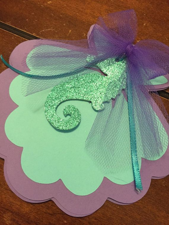 These shell under the sea inspired invitations are super cute and have the right touch of sparkle! Made out o card stock, ribbon and tulle, your little one is going to love them!    * Provide information for the invitation: date of the event, address, etc, and RSVP info in the note to seller or email me.   10 invitations with envelopes    Shipping will be made using Priority Mail, allow 2 to 4 business days for shipping.