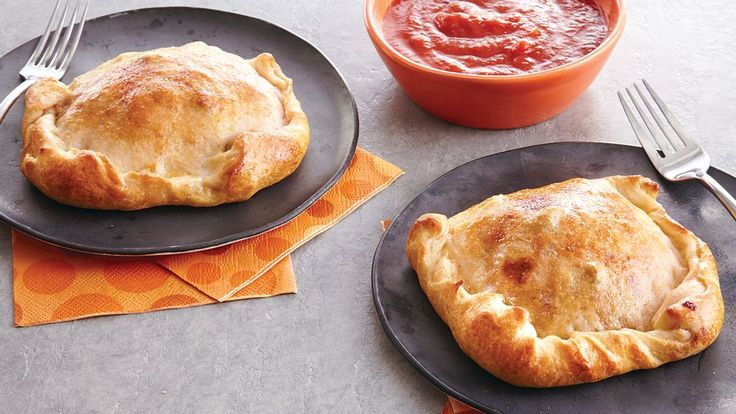 Add something flaky to your family's Italian dinner! Savor these yummy calzones made with Pillsbury™ pizza crust, sausages and pepper for this Halloween.
