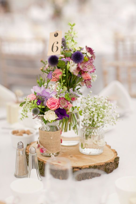 Wonderful summer flower centre pieces Image by Mirror Imaging #summer #wedding #fete #country #vintage #rustic #log #centrepiece