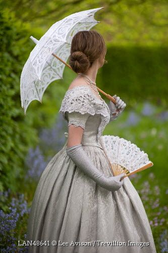 Trevillion Images - victorian-woman-with-fan-and-parasol