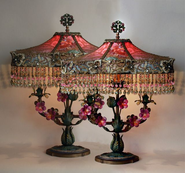 Romantic pair of antique, hand-painted dimensional tole lamps. The Katie shades are dyed fuschia to teal and covered in a trio of antique fabrics: on the top a Byzantine style gold metallic lace and 1920s beaded and sequined panels and around the cuff of the shades is rare and wonderful Edwardian beaded and jeweled trim. These light up beautifully with a dramatic glow. The shades are finished with hand beaded fringe in tones of pink, green, and gold with European and Swarovski crystal beads.