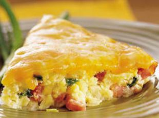Western Omelet Casserole  (Cooked overnight in a crockpot, or refrigerate overnight and bake in the AM)  Ingredients:  1 pkg (32 oz) frozen hashbrown potatoes  1 lg	onion (diced)  1 lb	lean ham (cubed about 1-inch)  2 c	cheddar cheese (shredded)  12 lg eggs (beaten well)  1/2 md each: green and red bell peppers (diced)  1 1/4 c milk   1/2 tsp salt  1 tsp ground black pepper