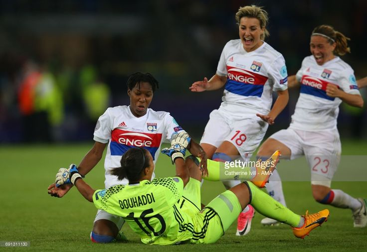 Kadeisha Buchanan of Olympique Lyonnais celebrates with Sarah Bouhaddi of Olympique Lyonnais during the UEFA Women's Champions League Final match between Lyon and Paris Saint Germain at Cardiff City Stadium on June 1, 2017 in Cardiff, Wales.