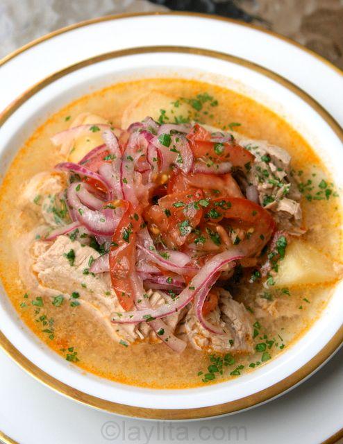 Encebollado de pescado (Ecuadorian onion fish soup) - fresh tuna, yuca or cassava root, tomatoes, onions, cilantro, spices served with curtido or pickled onions and tomatoes on top. Served round the clock, including breakfast.