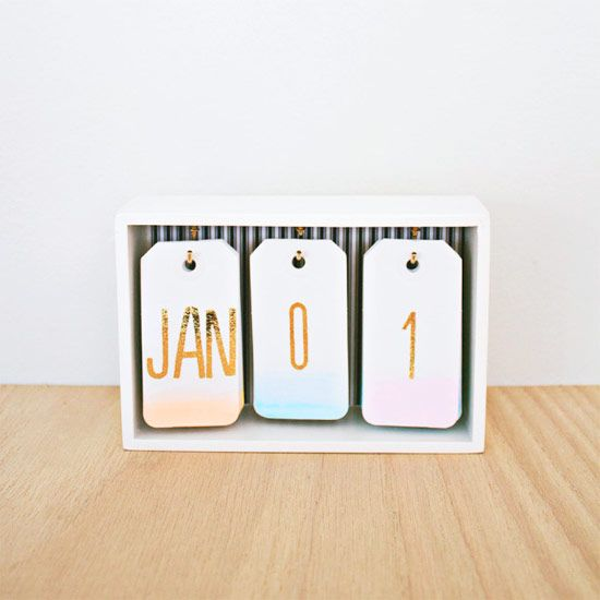 Make this lovely little desk calendar with watercolors and gift tags. The best part? You can use it every year!
