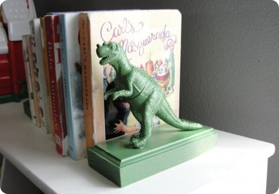 DIY bookends! What a simple and cool idea! maybe can use hot wheels or trucks too? the dinosours are pretty great though.