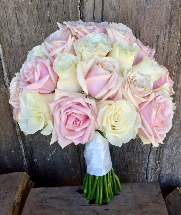 bouquet of sweet avalance and mondial roses  created by Lovely Bridal Blooms