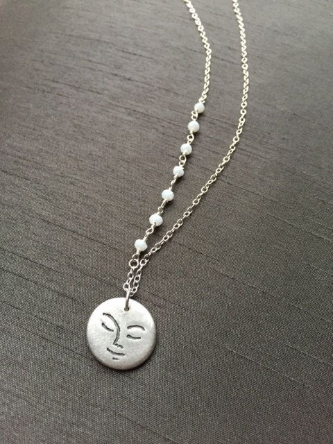 """New! A remake of another Sleepy Moon Pendant; this is handcrafted in fine silver (.999%) and hangs on a 17"""" sterling silver chain with dainty moonstones wire wrapped to one side. Perfect gift for the moon lovers! ($44) #moonjewelry #modernjewelry #silverjewelry"""