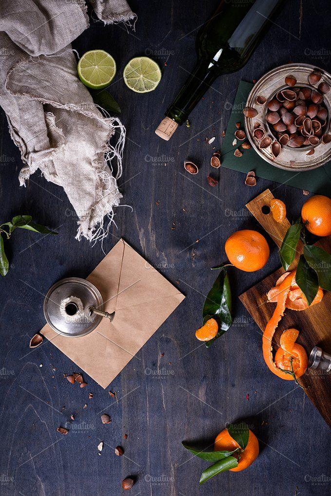 Ripe tasty tangerines with nuts by Iuliia Leonova on @creativemarket