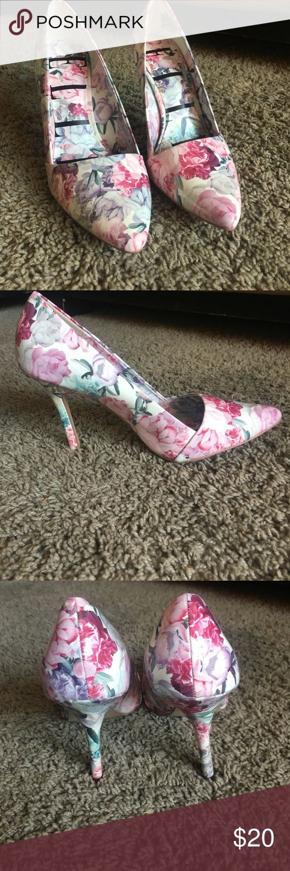Floral pink high heels Floral pink high heels! I'm 7.5 US, the shoe says 8 US. Wore once, maybe twice. They are in prefect condition! And so cute! Elle Shoes Heels