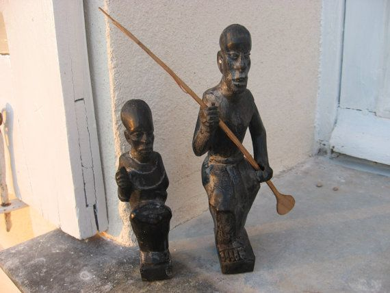 Emotive African Tribal Figurines, fabulous faces, 2 men, 1 seated, 1 kneeling with paddle, wonderful detailing, carved wood, stained black @PumpjackPiddlewick on Etsy
