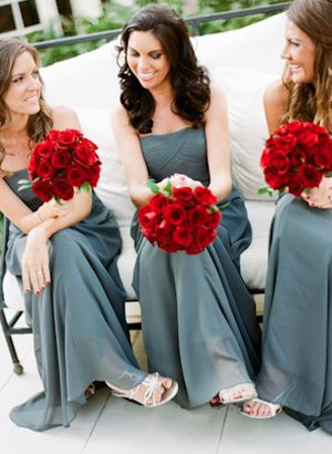 Red rose bouquets with grey / gray bridesmaid dresses.