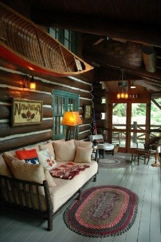 Every log cabin needs a porch and a canoe.  Cute. I would love to live in a cabin someday.