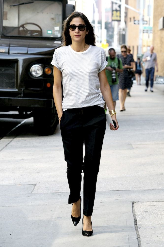 Capucine Safyurtlu in black trousers and a white t shirt