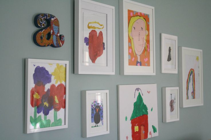 Like the idea of framing the kids art in the room