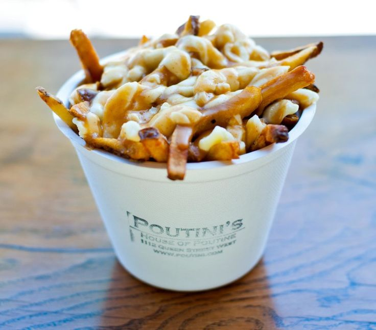 If I had to pick the best poutine in Toronto, I would have to go with Poutini's for their slick homemade gravy, melty curds and perfect hand-cut fries. And if you're going to go big, add an extra layer of curds for only $2. My 10 Must Eats Toronto -This Beautiful Day