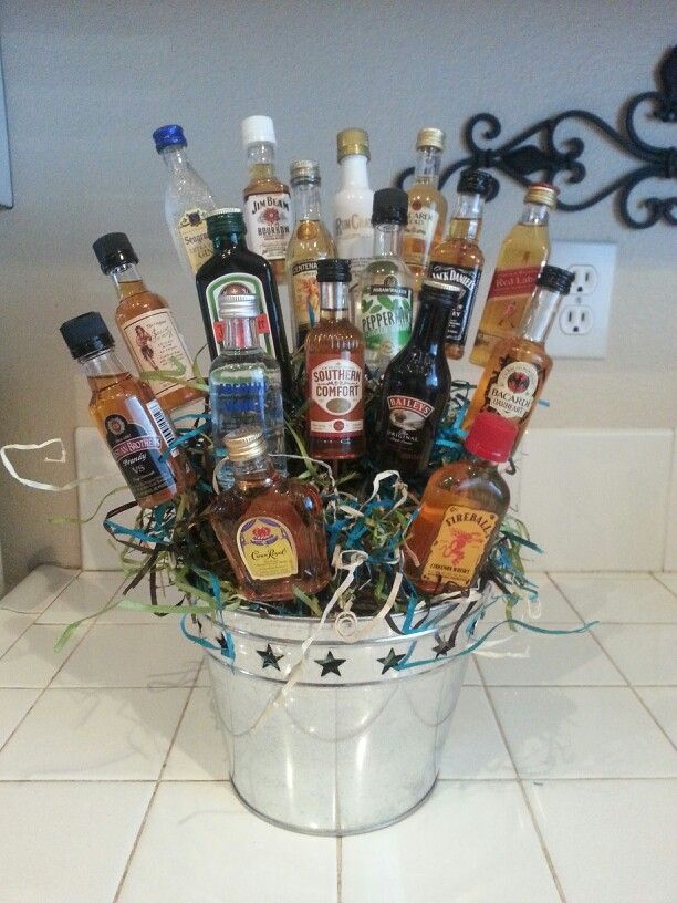 Bouquet of booze!! Super easy!!! Supplies needed.... bucket, skewers(wood), floral green foam, mini bottles of liquor, glue gun & gift filler/stuffing. Other things I've added are Cigars, lottery tickets eyc.. I Made this for my husband for a gift.