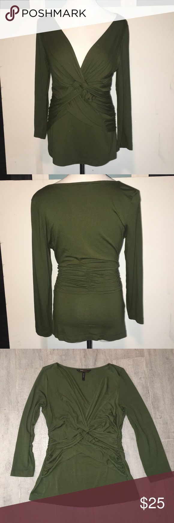 BCBG MAXAZRIA Olive Green Knotted Top Gently used. Three-quarter sleeves. Material: Rayon (95%), Spandex (5%). Machine wash cold. BCBGMaxAzria Tops Blouses