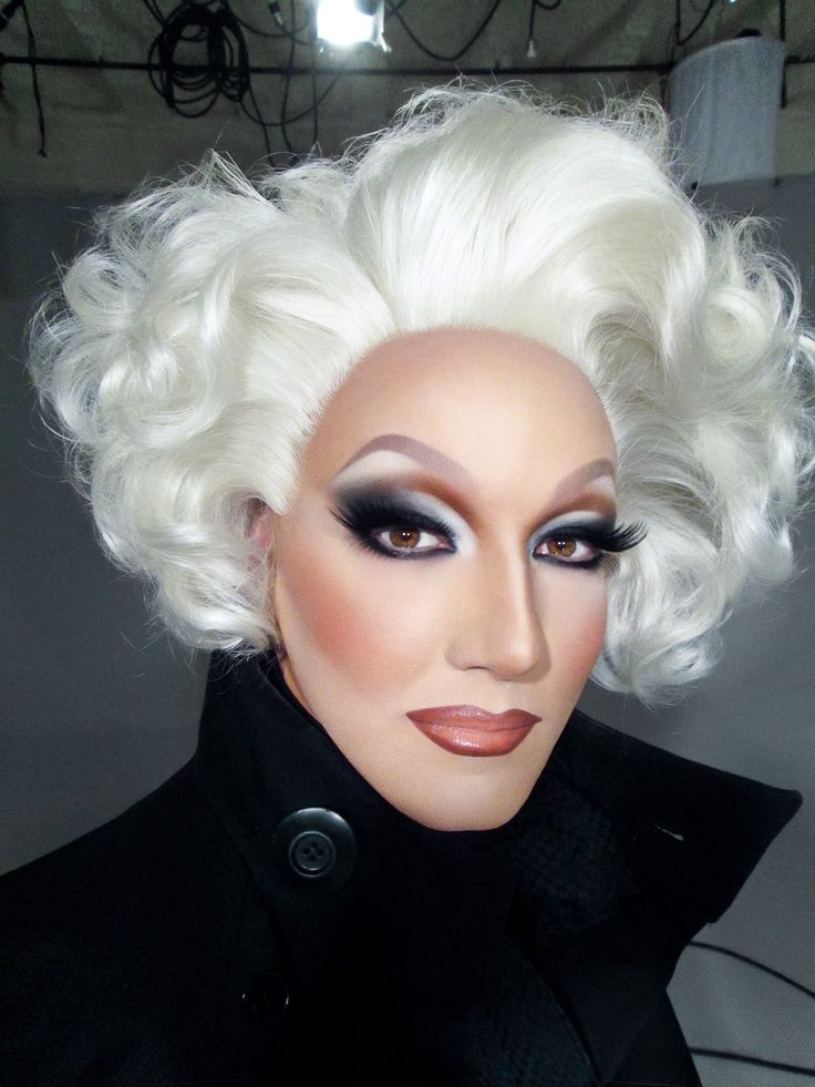 James St. James. This is a good representation of the use of earth tones to still achieve a dramatic effect. The blending here is superb but of course this performer must have shaved off his brows to achieve that effect. Note also the strong cheek contour with a bright highlight on the cheekbones. Also bright white lid with strong socket line shadow on the eyes.