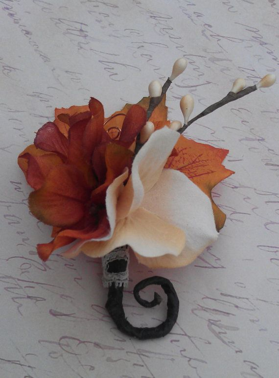 This rustic boutonniere is a great autumn companion! The beautiful fall hues of the maple leaves look so nice paired with the brown and ivory twigs! It is wrapped with copper colored wire and a large bittersweet satin ribbon, a copper swirl peeks out for a little added shine. This boutonniere is a nice addition to any fall day!  It will also make a great keep sake that will last for years to come.  *This listing is for 1 boutonniere as pictured. *Handmade to order/ ea leaf color & size vary…