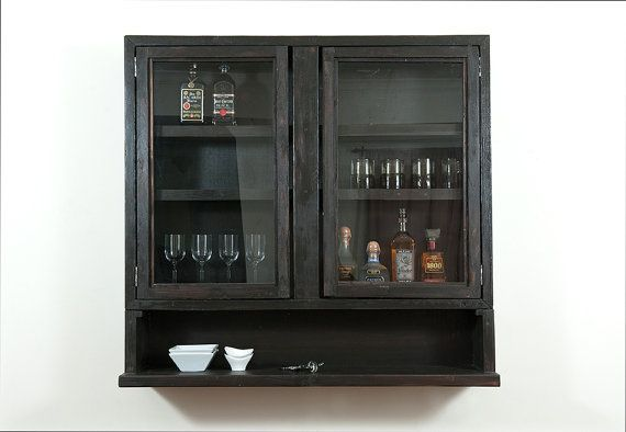 Liquor cabinet... Just use a bathroom above toilet cabinet with glass doors!