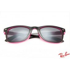 RayBans RB7788 Wayfarer sunglasses with pink frame and black lenses