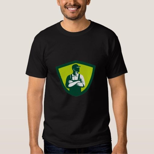 Organic Farmer Arms Folded Looking Side Crest Retr Tee Shirt. Illustration of an organic farmer wearing hat and overalls arms folded looking to the side viewed from front set inside shield crest on isolated background done in retro style. #Illustration #OrganicFarmerArmsFolded