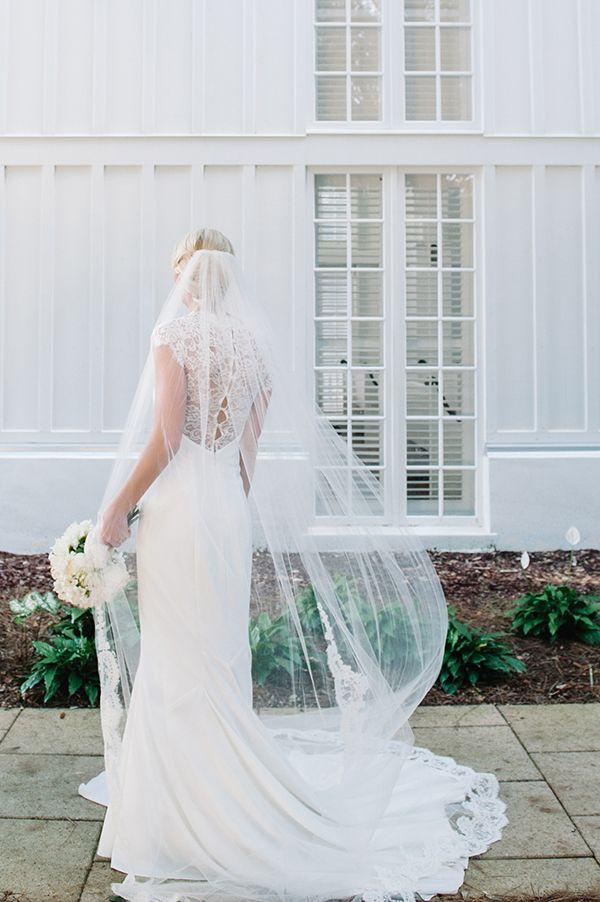 Amazing and elegant wedding dress | http://www.weddingpartyapp.com/blog/2014/07/07/preppy-beach-wedding-dear-wesleyann-photography/