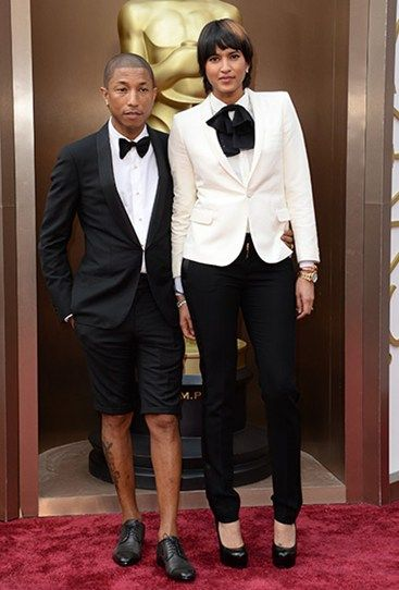 Bare legs on the Oscars red carpet? Pharrell Williams, you hussy! The singer and his wife and Helen Lasichanh couple dress for the third time in as many weeks. #Oscars
