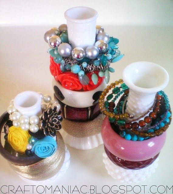 DIY Jewelery Organizer : use vases as a decorative way to display and organize bracelets and bangles.