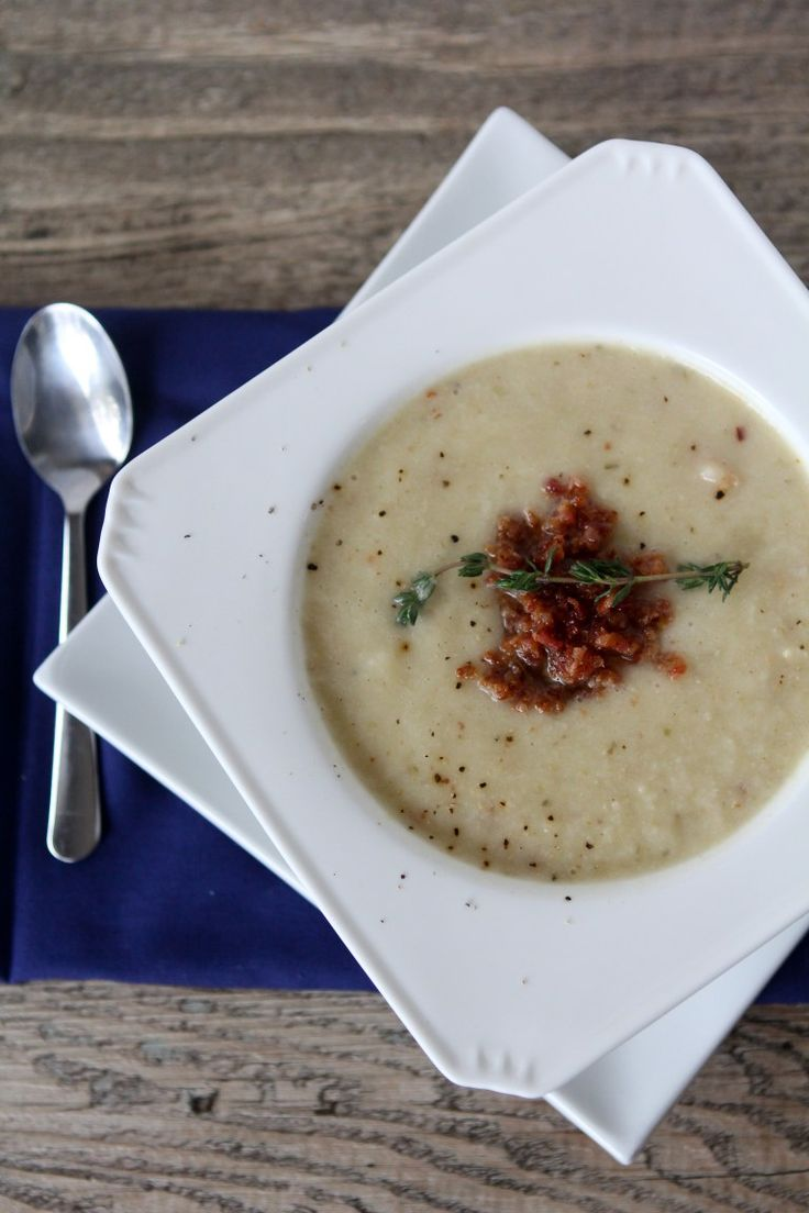 Paleo Roasted Cauliflower Soup recipe with bacon + thyme. Paleo friendly, gluten free and Whole30 compliant.